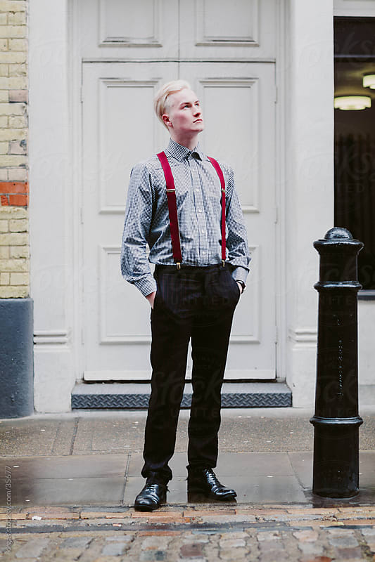 Long shot of a fashionable young man in Soho London. by kkgas for Stocksy United