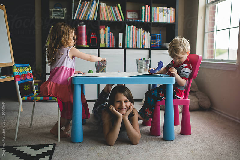 children playing around at home by Courtney Rust for Stocksy United