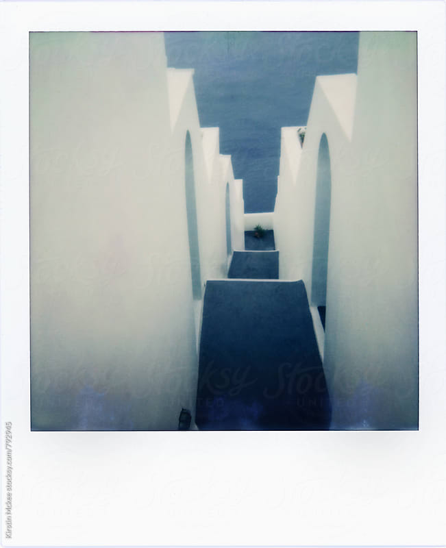 Polaroid of steps leading down to the sea, Santorini by Kirstin Mckee for Stocksy United
