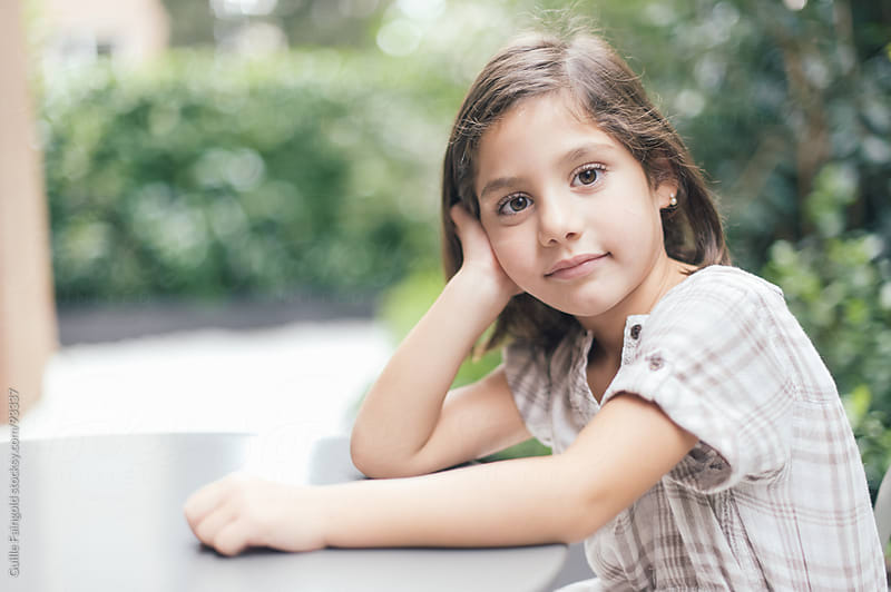 beautiful little girl posing While she waits in the dental clinic by Guille Faingold for Stocksy United