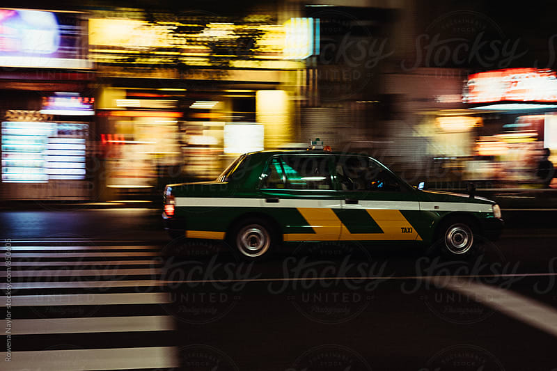 Tokyo Taxi cabs on the street at night by Rowena Naylor for Stocksy United