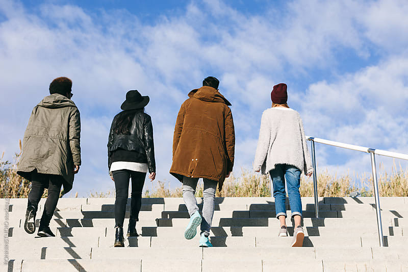 Back view of group of young friends in the city. by BONNINSTUDIO for Stocksy United