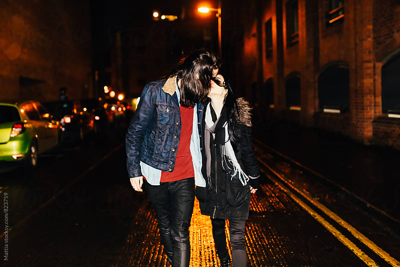 Young Couple Kissing in the Middle of the Street by HEX. for Stocksy United