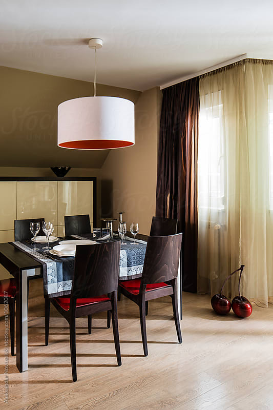 Contemporary dining room by Aleksandar Novoselski for Stocksy United