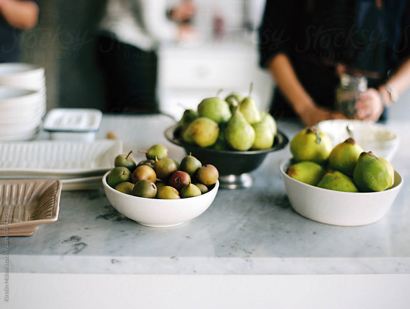 Bowls of pears on a surface by Kirstin Mckee for Stocksy United