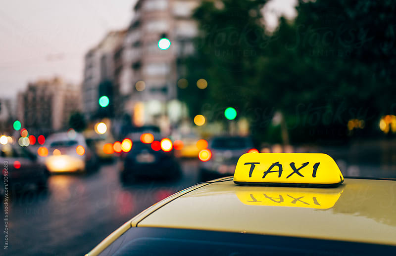 Taxi in Athens, Greece by Nasos Zovoilis for Stocksy United