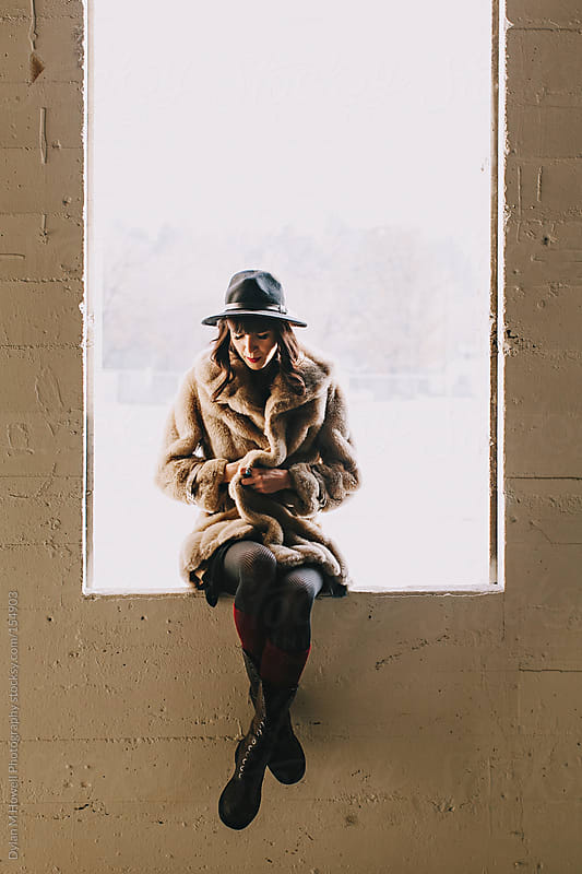 Girl in window by Dylan M Howell Photography for Stocksy United
