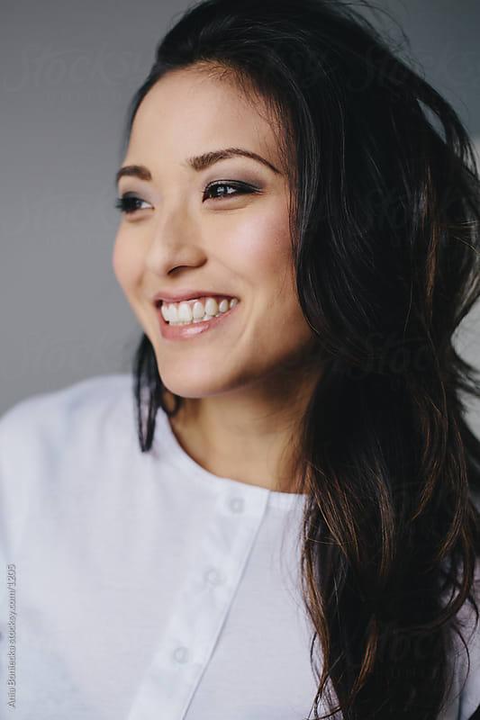 Smiling Asian girl portrait by Ania Boniecka for Stocksy United