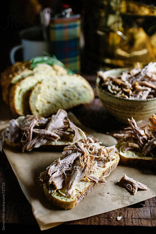Pulled pork on cornbread lunch. by Darren Muir for Stocksy United
