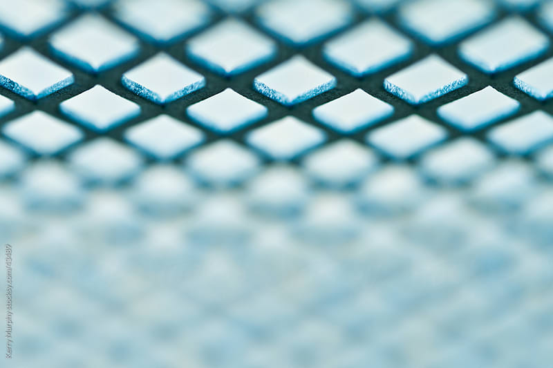 Macro abstract of metal grate pattern by Kerry Murphy for Stocksy United