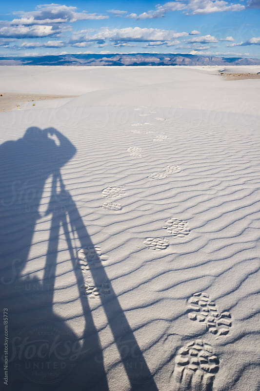 Photographers Shadow on White Sand by Adam Nixon for Stocksy United
