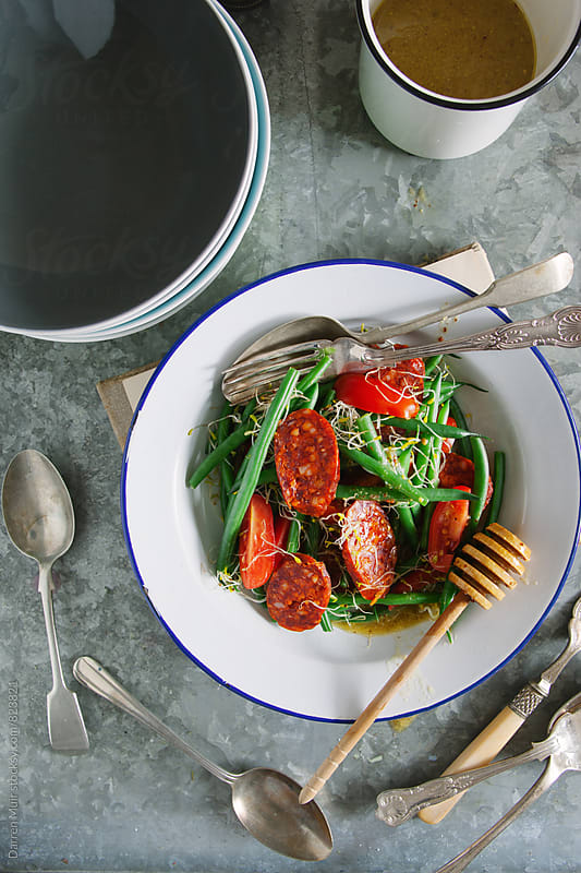 Green bean and chorizo salad. by Darren Muir for Stocksy United
