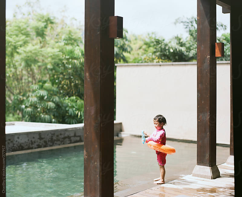 little girl playing in the pool  by ChaoShu Li for Stocksy United