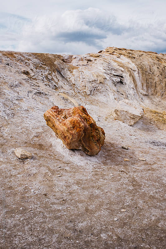 colorful rock in geothermal location  by Jesse Morrow for Stocksy United