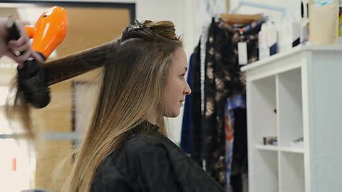 efcbe9c1db50 blow dry at the hairdresser by Gillian Vann for Stocksy United