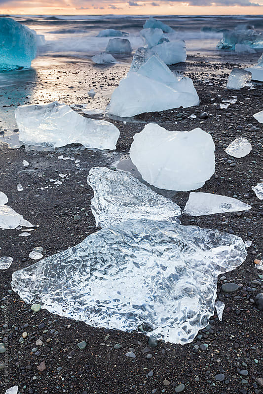 Icebergs at Jokulsarlon black sand beach by Marilar Irastorza for Stocksy United