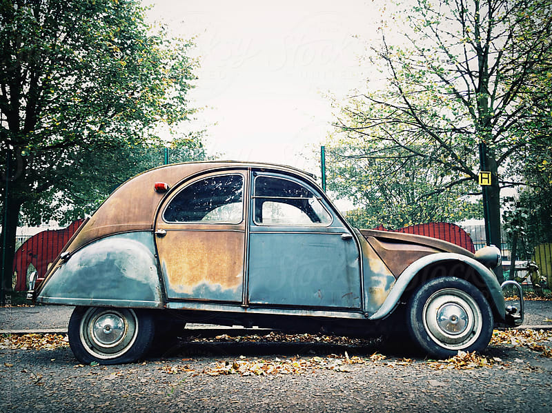 A rusty, multi colored Citroen car. by James Ross for Stocksy United