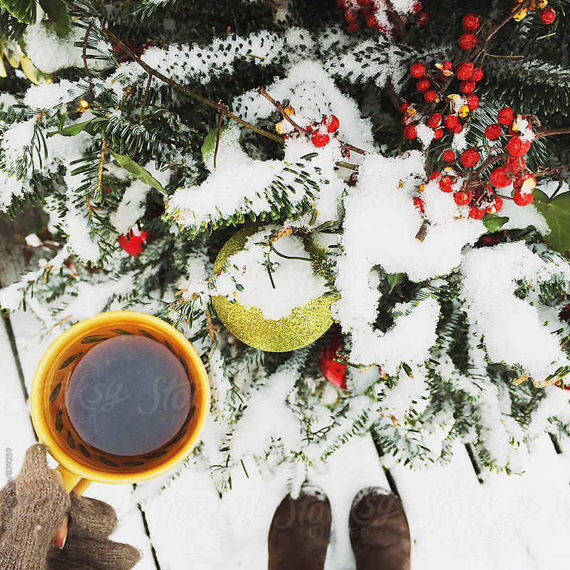 Morning coffee outdoors with the Christmas Tree by Holly Clark for Stocksy United