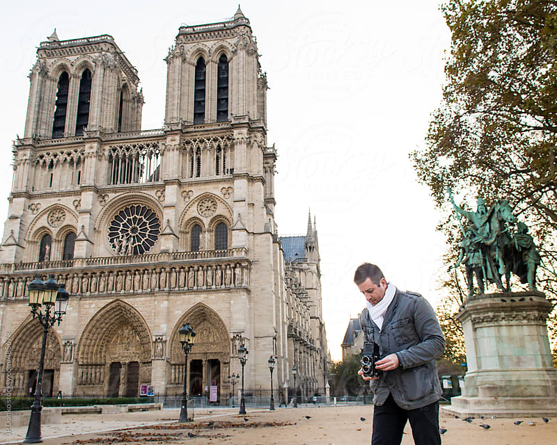 Tourist Photographing Notre Dame de Paris with Vintage Medium Format Film Camera by JP Danko for Stocksy United