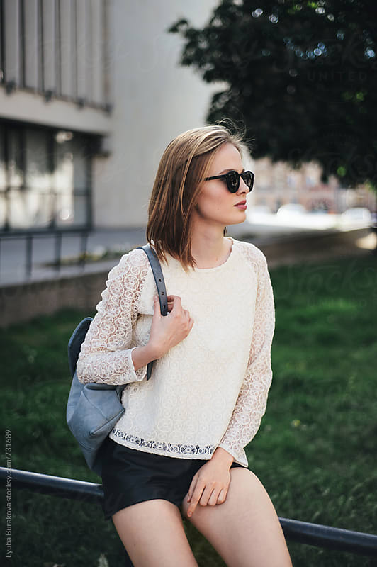 Young woman with backpack  by Liubov Burakova for Stocksy United