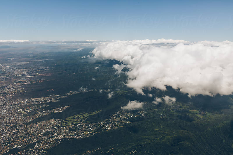 Aerial view of cityscape under clouds by unite images for Stocksy United