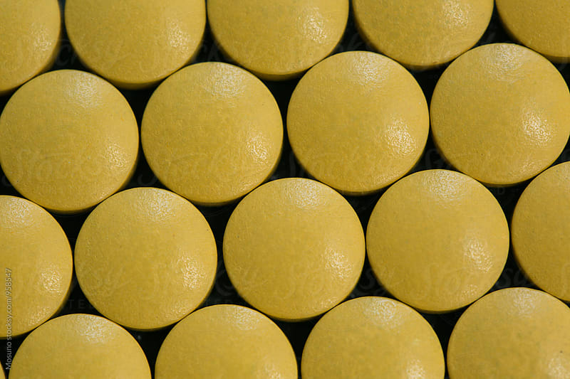 Close Up of a Yellow Pills by Mosuno for Stocksy United