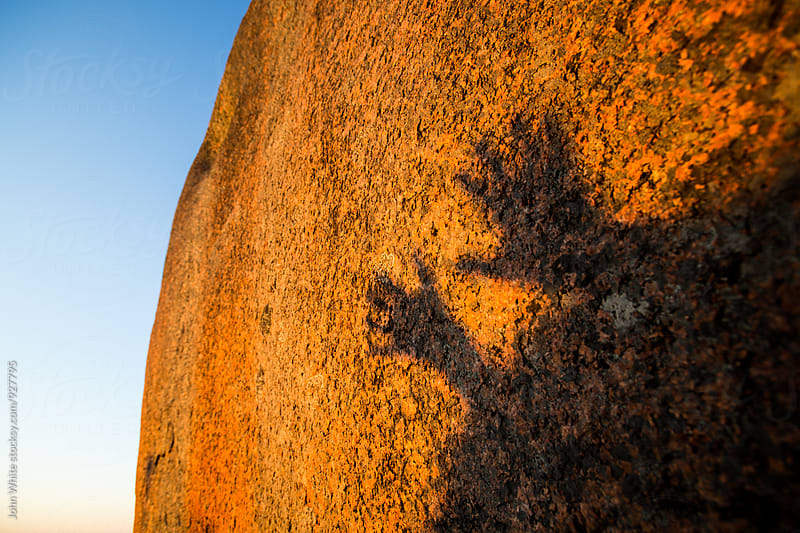 Shadow of hands on rock. Murphy's Haystacks by John White for Stocksy United