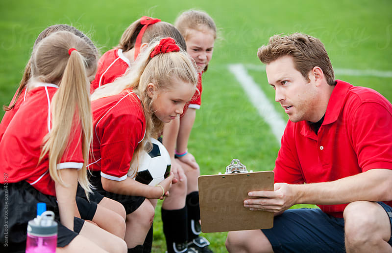 Soccer: Coach Discussing Strategy for Game by Sean Locke for Stocksy United
