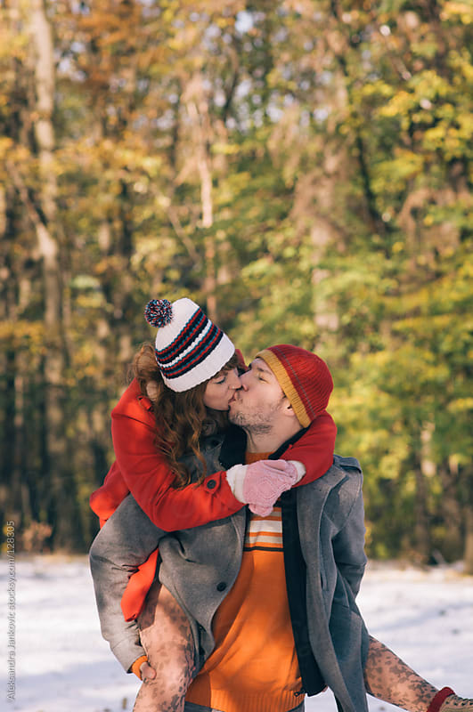 Happy young couple kissing in the nature by Aleksandra Jankovic for Stocksy United
