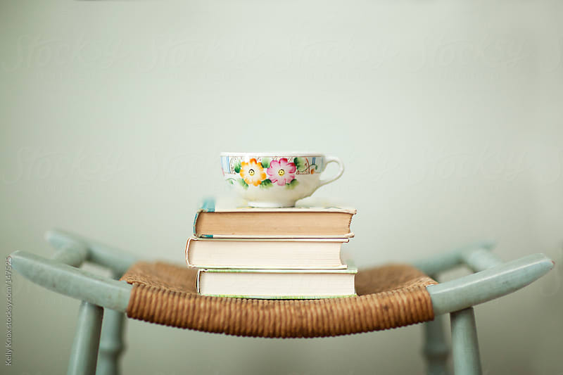 teacup on a stack of books by Kelly Knox for Stocksy United