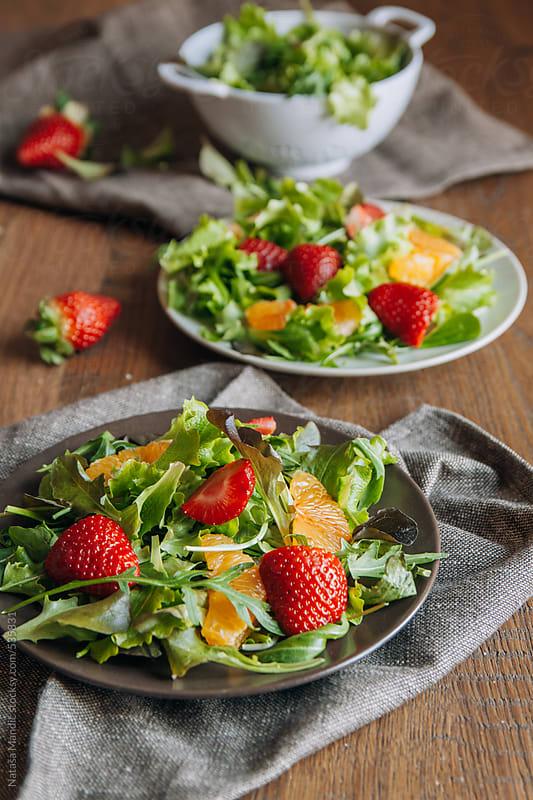 Fresh salad with strawberries and orange by Nataša Mandić for Stocksy United