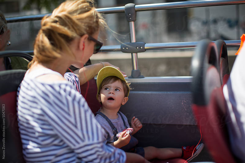 Mother with her son in a bus by Nasos Zovoilis for Stocksy United