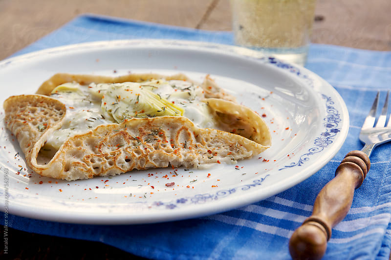 Artichoke crepes by Harald Walker for Stocksy United