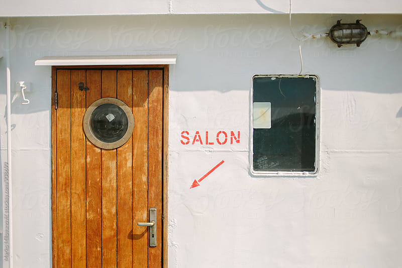 Salon sign on the ferry boat by Marko Milovanović for Stocksy United