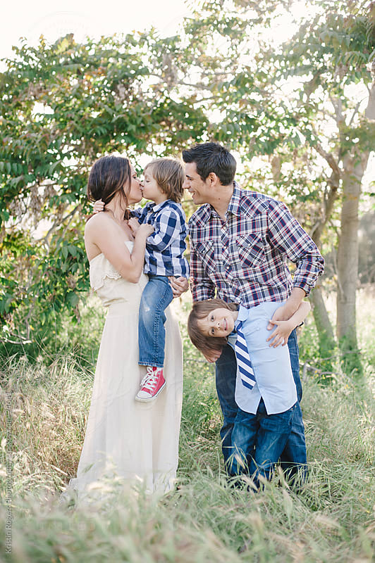Playful loving family moments by Kristin Rogers Photography for Stocksy United
