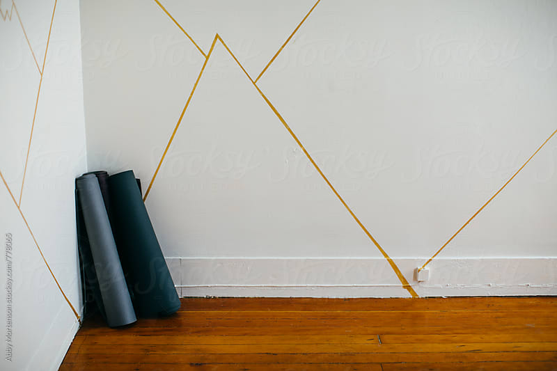 Yoga Mats against Studio Wall by Abby Mortenson for Stocksy United
