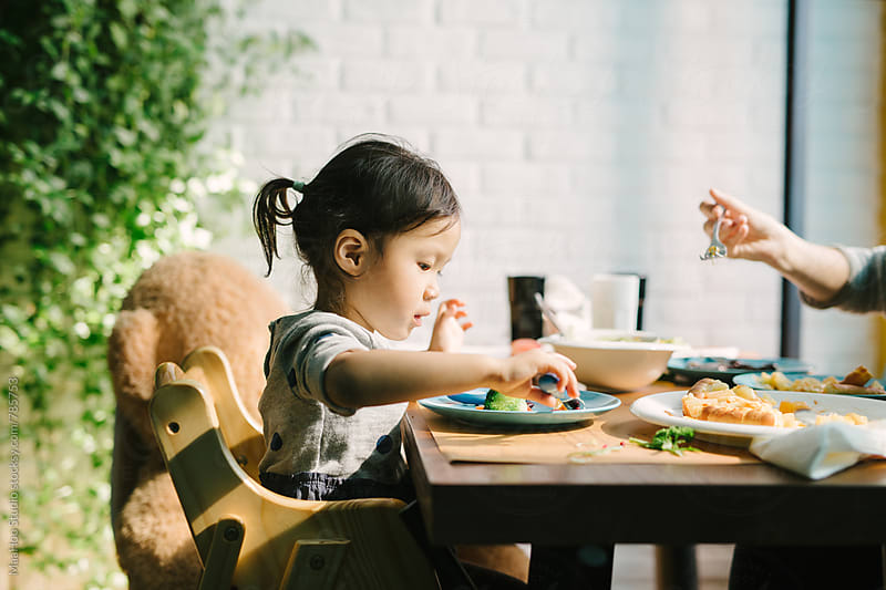 Toddler girl having lunch by MaaHoo Studio for Stocksy United
