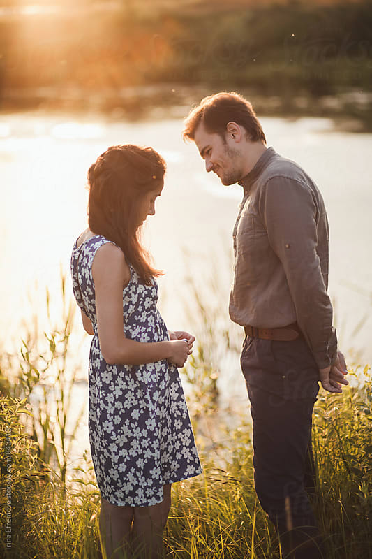 Couple in the countryside on the sunset  by Irina Efremova for Stocksy United