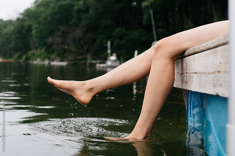Woman's Legs Splashing in the lake by Gabriel (Gabi) Bucataru for Stocksy United