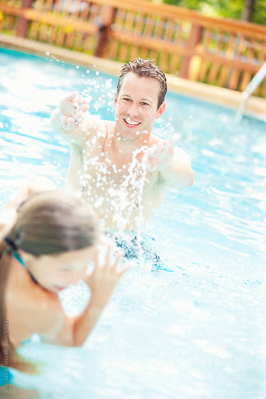 Swimming: Father Plays Splashing Games with Child by Sean Locke for Stocksy United