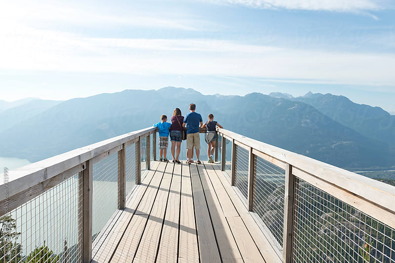 Family At Spectacular Mountainside Lookout by Ronnie Comeau for Stocksy United