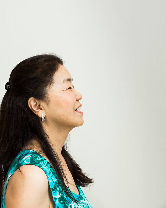Senior Asian woman profile with white background by yuko hirao for Stocksy United
