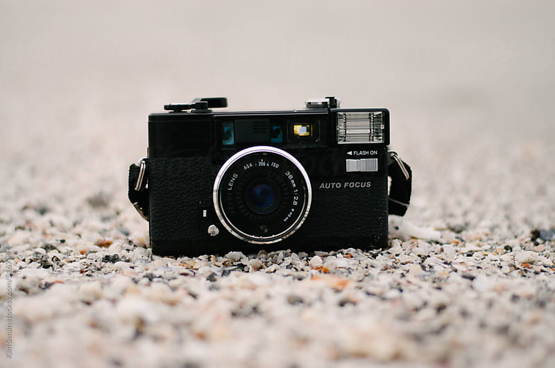 Camera on the beach by Kim Swain for Stocksy United