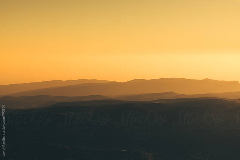landscape with mountains at sunset by Javier Pardina for Stocksy United