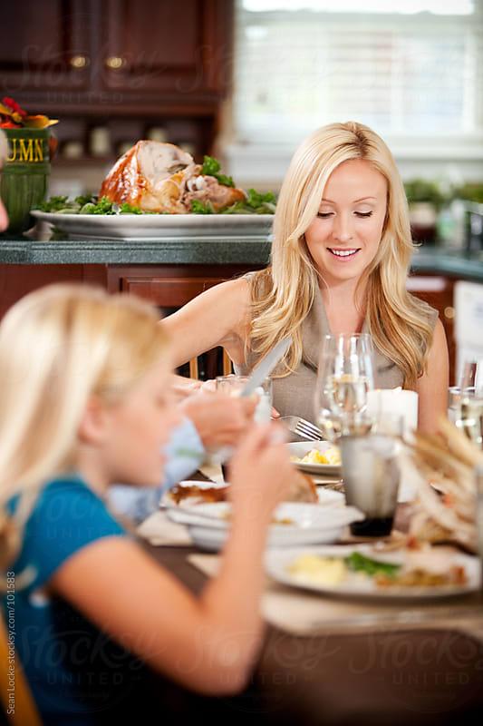 Thanksgiving: Family Eating Dinner by Sean Locke for Stocksy United