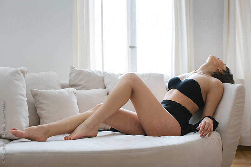 Sensual Caucasian Brunette in Black Underwear in Erotic Pose on Sofa by Julien L. Balmer for Stocksy United