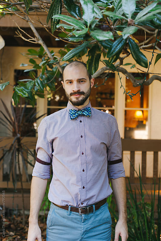 Young Man with a Beard wears a Bowtie by Caleb Thal for Stocksy United