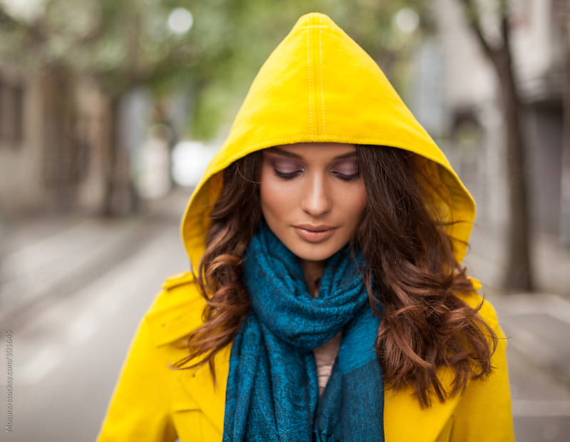 Beautiful Woman in a Yellow Hoodie by Mosuno for Stocksy United