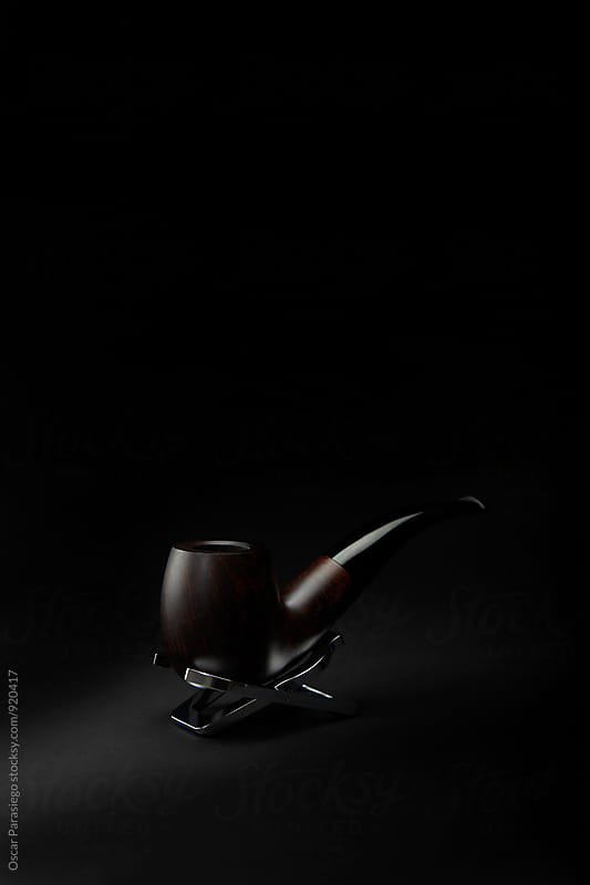 Elegant pipe in a black Background by Oscar Parasiego for Stocksy United