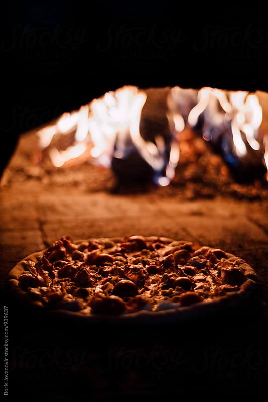 Pizza in the oven  by Boris Jovanovic for Stocksy United